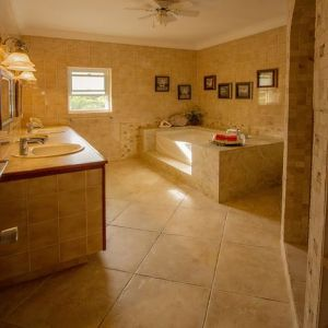 Upstairs bathroom has a luxurious soaking tub along with tiled shower.