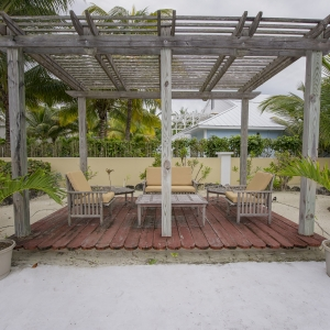 The poolside Pergola offers a cozy getaway
